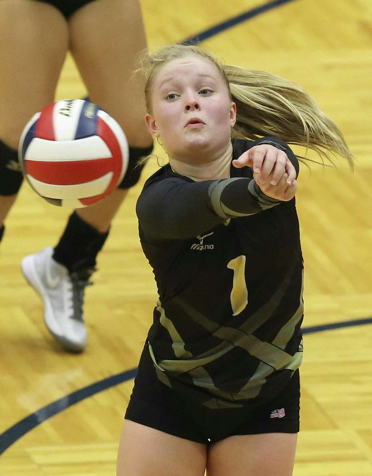 Brennan Libero Makenna Hanssen snares a shot as Clark plays Brennan in volleyball at Taylor Field House on August 30, 2016