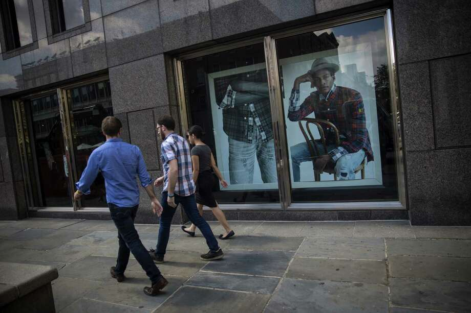 Pedestrians pass by an Abercrombie & Fitch Co. store in New York. At least half of Abercrombie's customers are now over 20, the company says.  Photo: Eric Thayer / © 2016 Bloomberg Finance LP