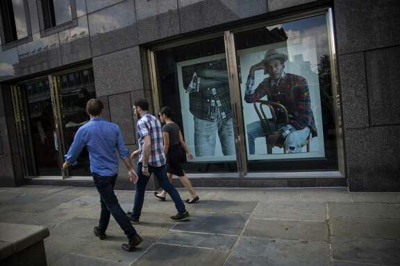 Pedestrians pass by an Abercrombie & Fitch Co. store in New York. At least half of Abercrombie's customers are now over 20, the company says.