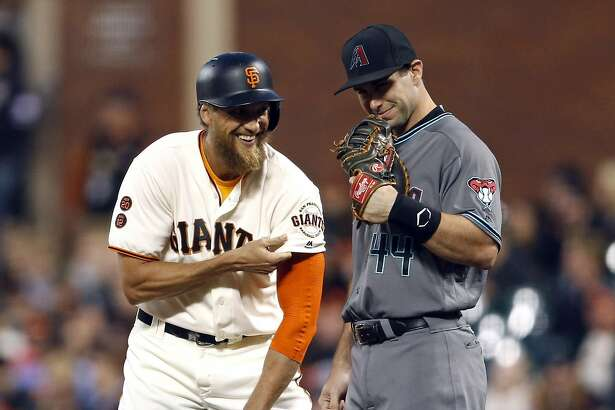 San Francisco Giants' Hunter Pence jokes with Arizona Diamondbacks' Paul Goldschmidt after Pence's 2nd inning single during MLB game at AT&T Park in San Francisco, Calif., on Tuesday, August 30, 2016.