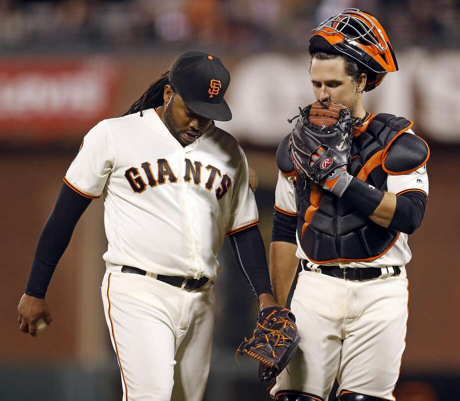 Johnny Cueto and Buster Posey confer during a 2016 game. Photo: Scott Strazzante, The Chronicle