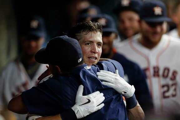 Colby Rasmus receives a warm greeting from Luis Valbuena after homering in the second inning.