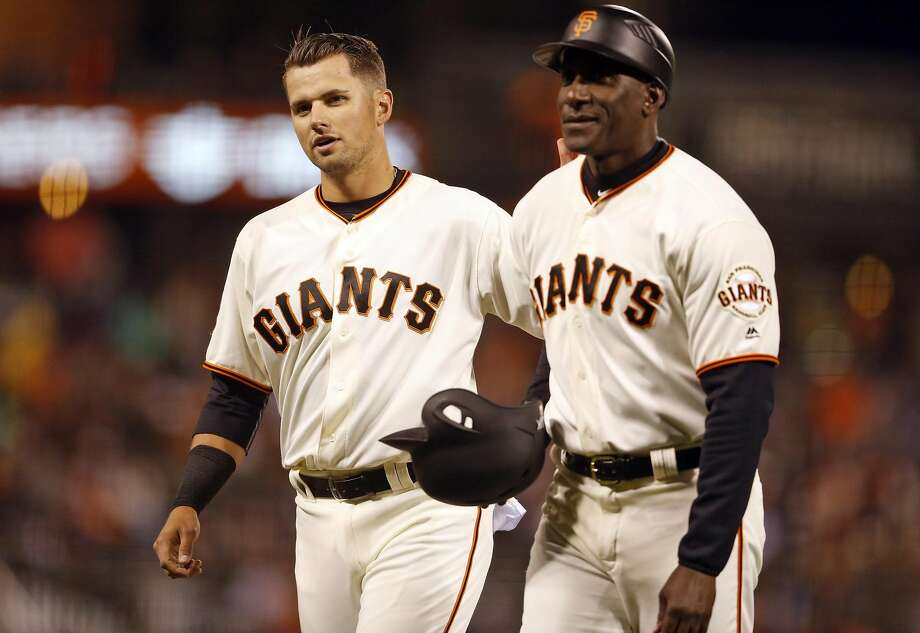 San Francisco Giants' Joe Panik and 3rd base coach Roberto Kelly against Arizona Diamondbacks during MLB game at AT&T Park in San Francisco, Calif., on Tuesday, August 30, 2016. Photo: Scott Strazzante, The Chronicle