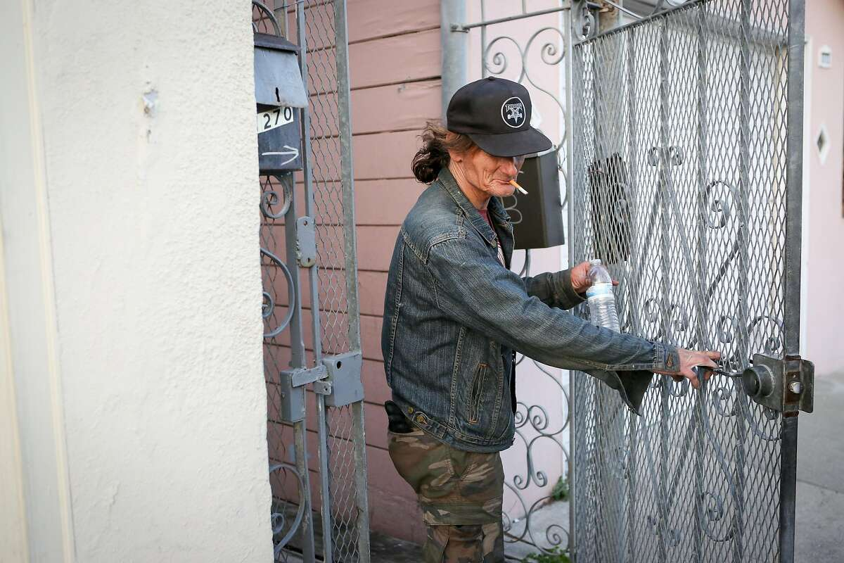 Veteran Eric Clark closes the entrance gate at 1270 Fitzgerald Ave in the Bayview neighborhood in San Francisco on Aug. 30th, 2016. Clark is happy to defend Judy Wu's character and says she has done many good things for her tenants