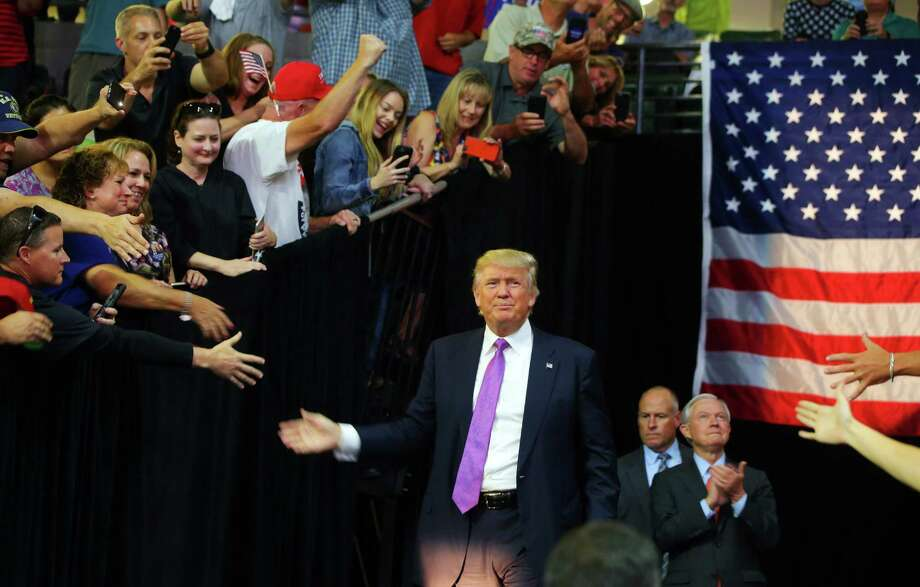 The Trump base:  The Republican candidate greets supporters during 2016 rally in Eveeerett.. Photo: GENNA MARTIN, SEATTLEPI.COM / SEATTLEPI.COM