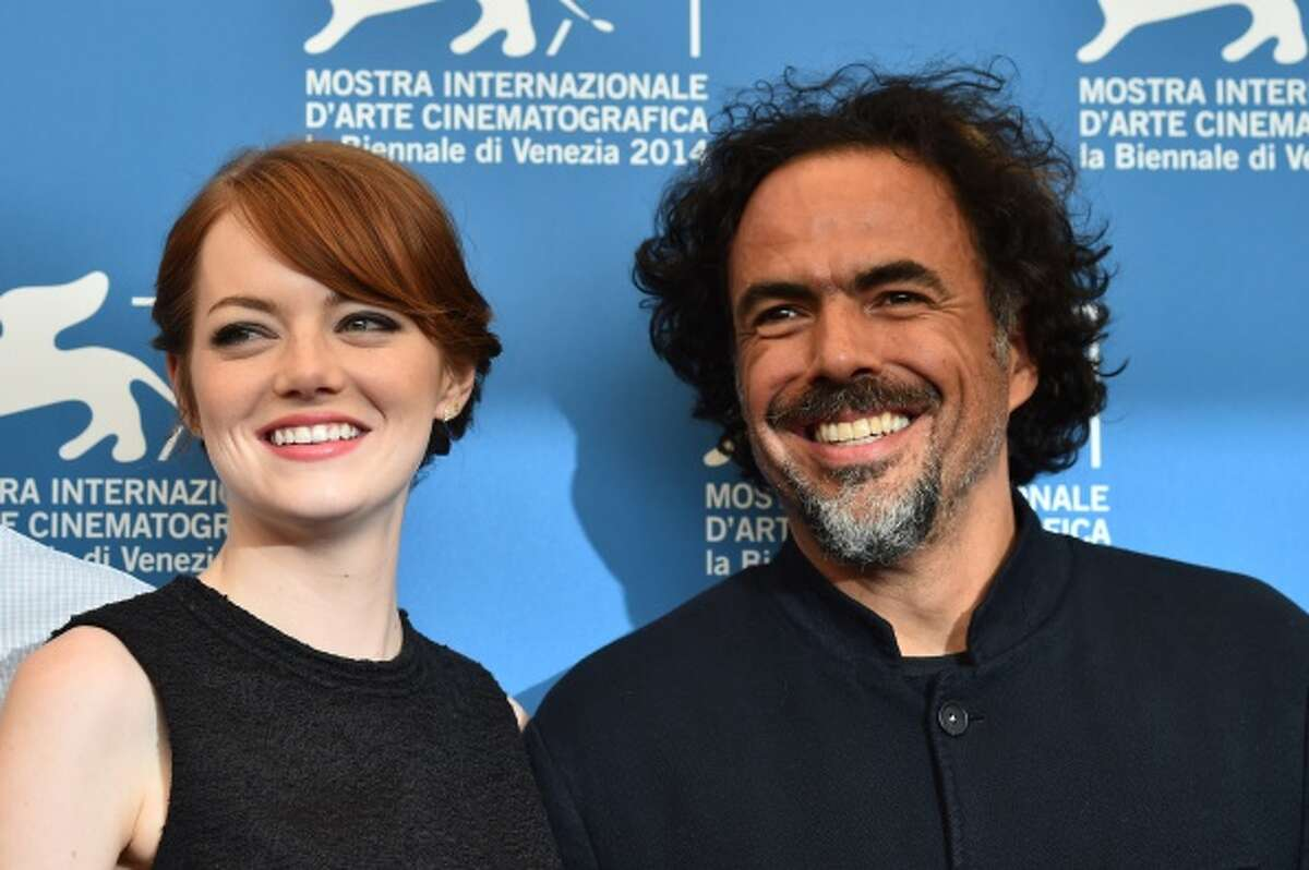 Mexican director Alejandro Inarritu poses with US actress Emma Stone during the photocall of the movie