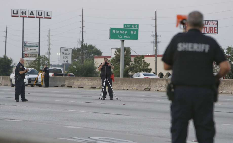 Police are shown at the scene where a pedestrian was killed on I-45 northbound between Richey Rd. and FM 1960, Wednesday, August 31, 2016 in Houston.  ( Melissa Phillip / Houston Chronicle ) Photo: Melissa Phillip/Houston Chronicle