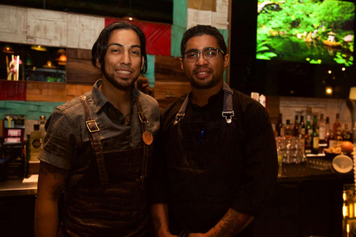 David A and Tito Bradshaw are at the bar at Botika.