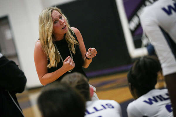 Willis head coach Ashley Farris rallies her team during a timeout in the varsity volleyball game against Bryan Rudder on Tuesday, Aug. 30, 2016, at Willis High School. To view more photos from the game, go to HCNPics.com.