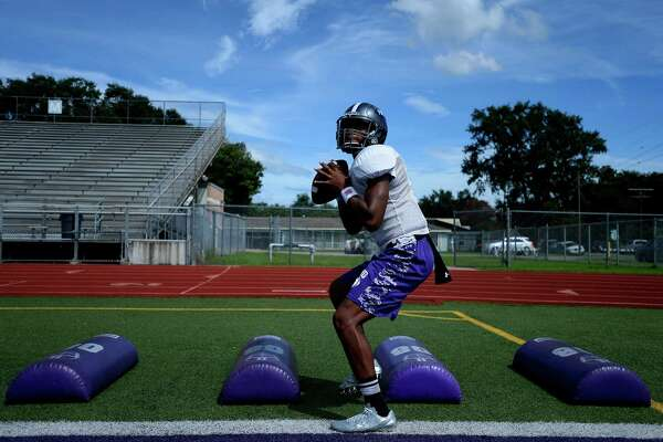 Port Neches-Groves' sophomore quarterback Roschon Johnson does a footwork drill during practice on Monday afternoon.  Photo taken Monday 8/29/16 Ryan Pelham/The Enterprise