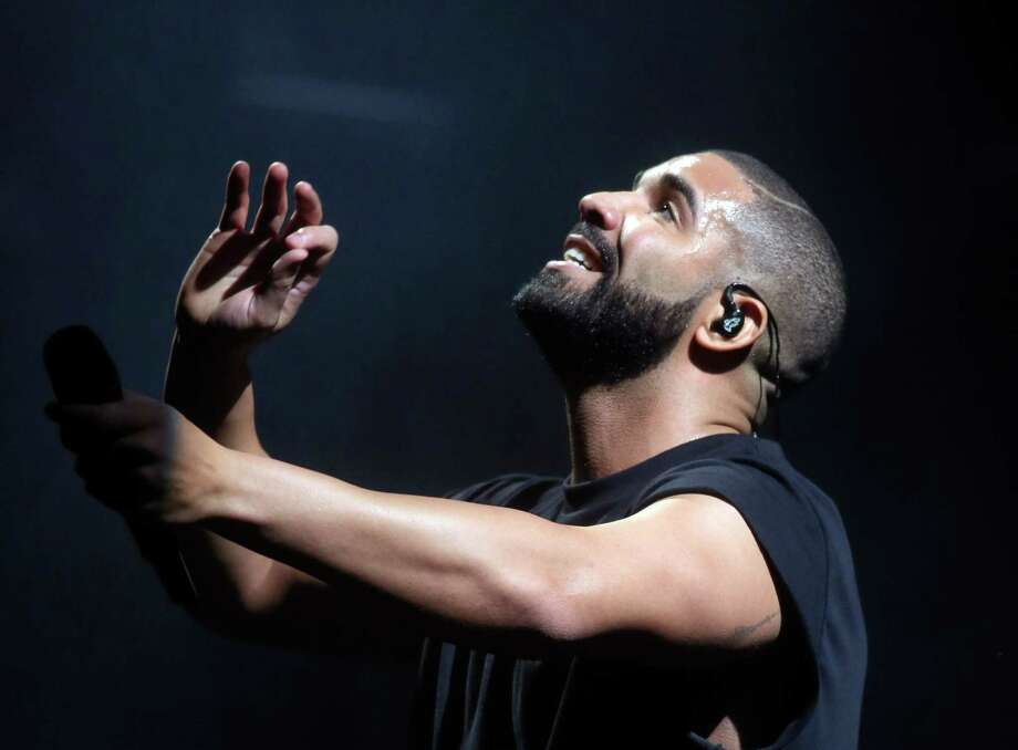 Canadian rapper Drake earned 13 American Music Awards nominations. Photo: Jack Plunkett, INVL / Invision