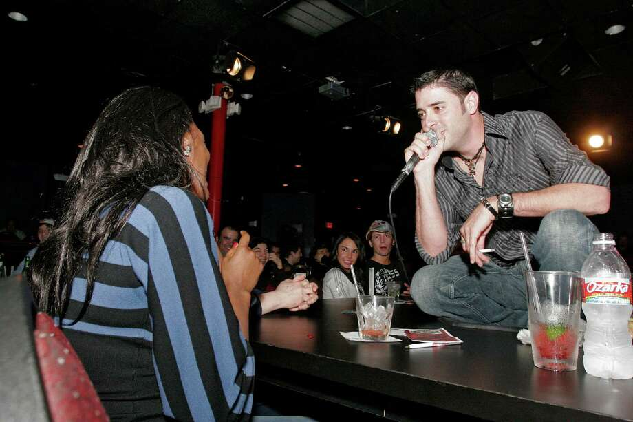 Bill Olive-for the chronicle. 02/21/08. 526 Waugh Dr., Houston, Tx. The Whiskey Brothers' Slade Ham heckles an audience member during his performance Wednesday at the Laff Stop. Photo: Bill Olive, Freelance / © Bill Olive 2008