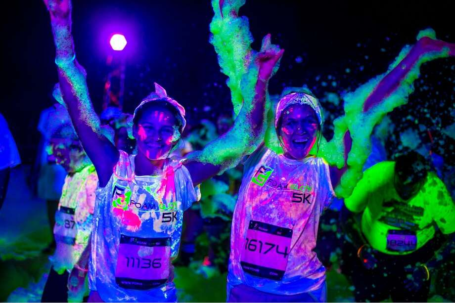 Take part in some good, clean and glowingly colorful fun Saturday evening during the Foam Glow 5K at Sam Houston Race Park. The more white clothing you wear, the more you'll glow in the dark. Photo: 1n3 LLC