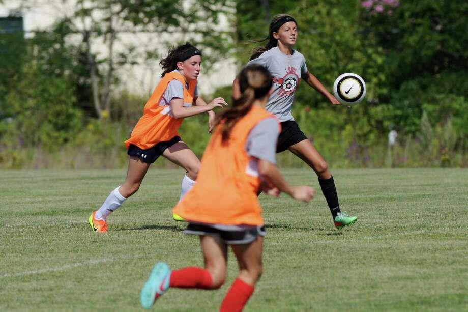 Guilderland High School girl's soccer players take part in practice on Wednesday, Aug. 24, 2016, in Guilderland, N.Y.  (Paul Buckowski / Times Union) Photo: PAUL BUCKOWSKI / 20037763A