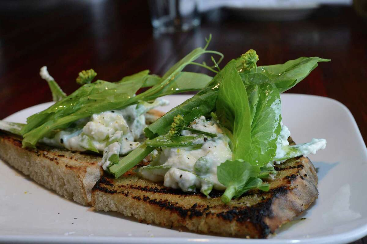 The popularity of Folc's burger has overshadowed even its most-recognized dish, the pea toast.