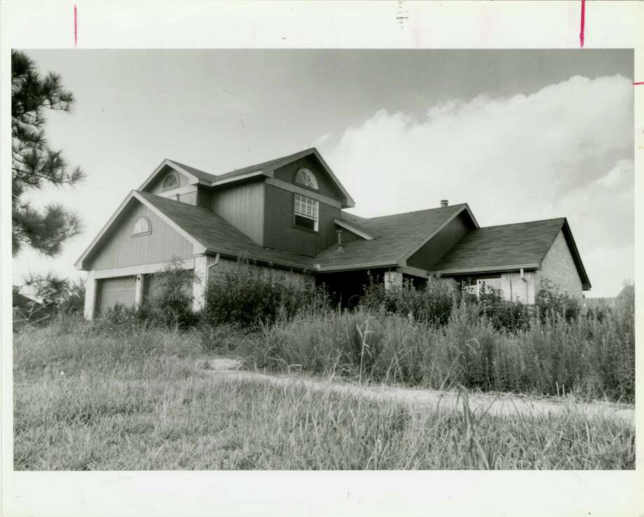 10/1986 - An abandoned house overrun by weeds located in the Forestwood subdivision. Photo: James Drummond, HC Staff / Houston Chronicle