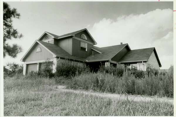 10/1986 - An abandoned house overrun by weeds located in the Forestwood subdivision.