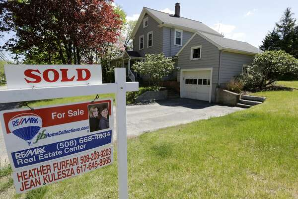"""FILE - This Wednesday, May 18, 2016, file photo shows a """"Sold"""" sign in front of a house in Walpole, Mass. On Wednesday, Aug. 31, 2016, the National Association of Realtors releases its July report on pending home sales, which are seen as a barometer of future purchases. (AP Photo/Steven Senne, File)"""