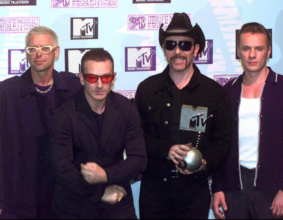 Irish band U2 pose with the Best Live award at the presentation of the MTV Music Awards in Rotterdam, Netherlands Thursday Nov. 6, 1997. (AP Photo/Dusan Vranic)