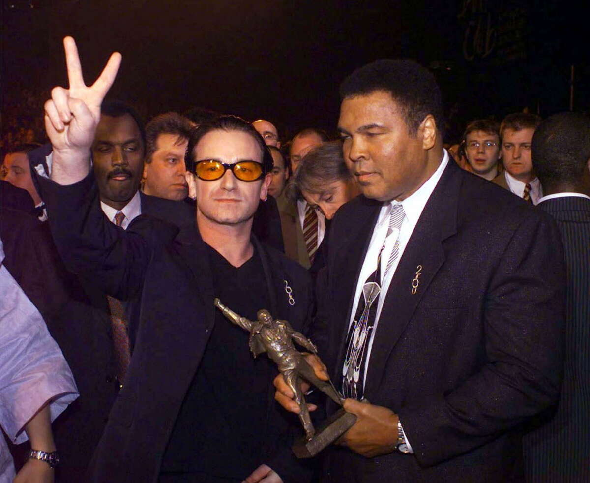 Bono, left, frontman for Irish rock band U2, and former Heavyweight Boxing Champion of the World Mohammed Ali, accept a special award on behalf of Jubilee 2000, Tuesday February 16, 1999, at the Brit Awards ceremony at the London Arena. The special Freddie Mercury Award was given to honour a campaign against third world debt.(AP Photo / Neil Munns) **UK OUT, MAGS OUT, NO SALES**