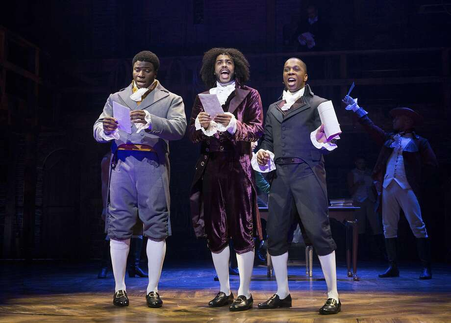 """FILE -- Daveed Diggs, center, as Thomas Jefferson, with Okieriete Onaodowan, left, and Leslie Odom Jr. in """"Hamilton,"""" at the Richard Rodgers Theatre in New York, July 11, 2015. Jefferson is sent up as a flamboyant, scheming hypocrite in the hit musical — just one of a number of recent attacks on the third president's reputation. (Sara Krulwich/The New York Times) Photo: SARA KRULWICH, NYT"""