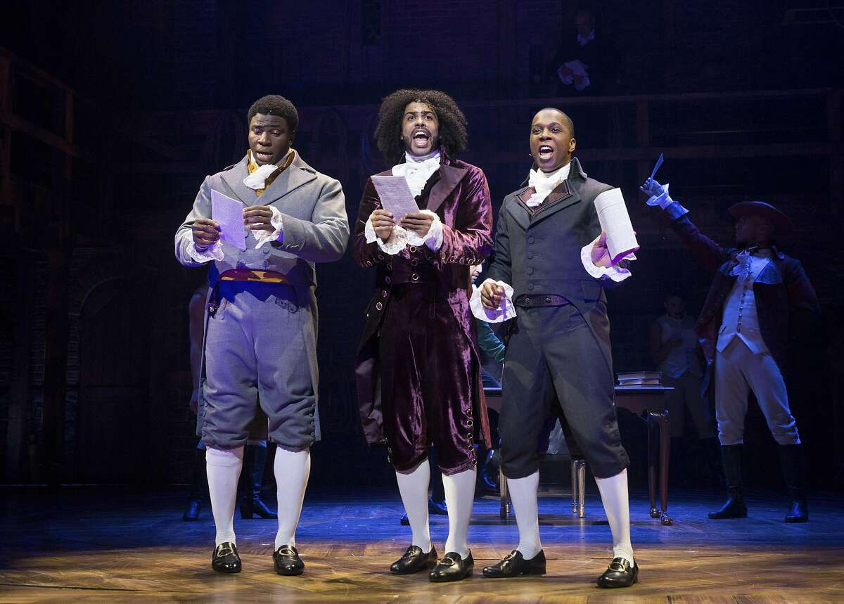 FILE -- Daveed Diggs, center, as Thomas Jefferson, with Okieriete Onaodowan, left, and Leslie Odom Jr. in �Hamilton,� at the Richard Rodgers Theatre in New York, July 11, 2015. Jefferson is sent up as a flamboyant, scheming hypocrite in the hit musical � just one of a number of recent attacks on the third president�s reputation. (Sara Krulwich/The New York Times)