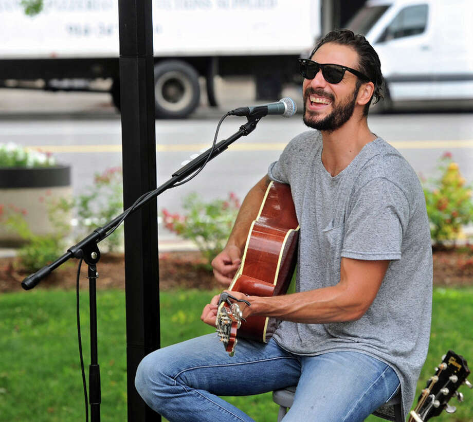 Songwriter Griffin Anthony performing in July. Photo: / H. John Voorhees III