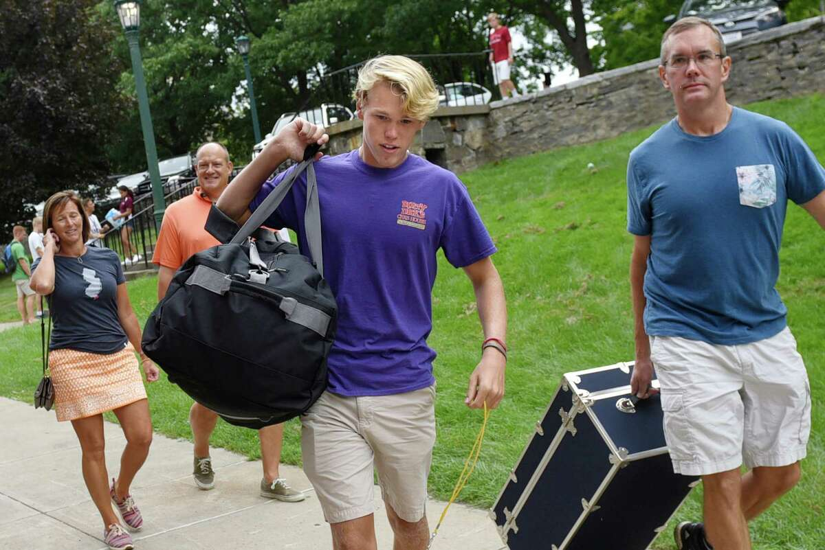 Freshman Edward Winters, 18, center, of Allendale, N.J. gets help moving into his dorm on Wednesday, Aug. 31, 2016, at Union College in Schenectady, N.Y. (Cindy Schultz / Times Union)