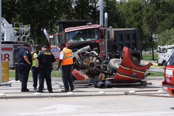 Emergency personnel are shown at a crash scene involving a Metro Light Rail Train and a dump truck on MLK at S. Macgregor Way Wednesday, August 31, 2016 in Houston.  ( Melissa Phillip / Houston Chronicle )