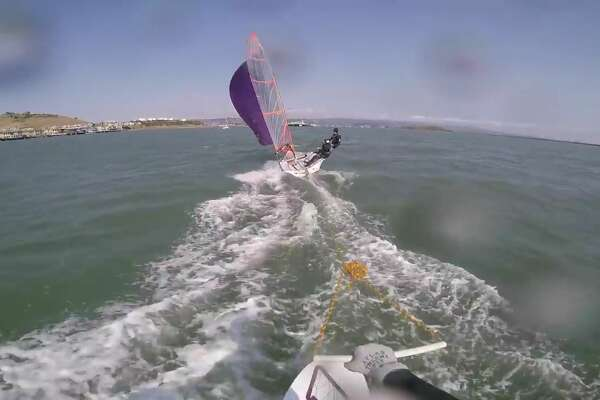 "Neil Marcellini wakeboards on a special foil board behind a 14-foot ""29er"" racing dinghy sailed by Aidan Doyle and Andrew Klotz near Richmond, Calif. in August, 2016.  (Photo copyright Neil Marcellini, used by permission)"