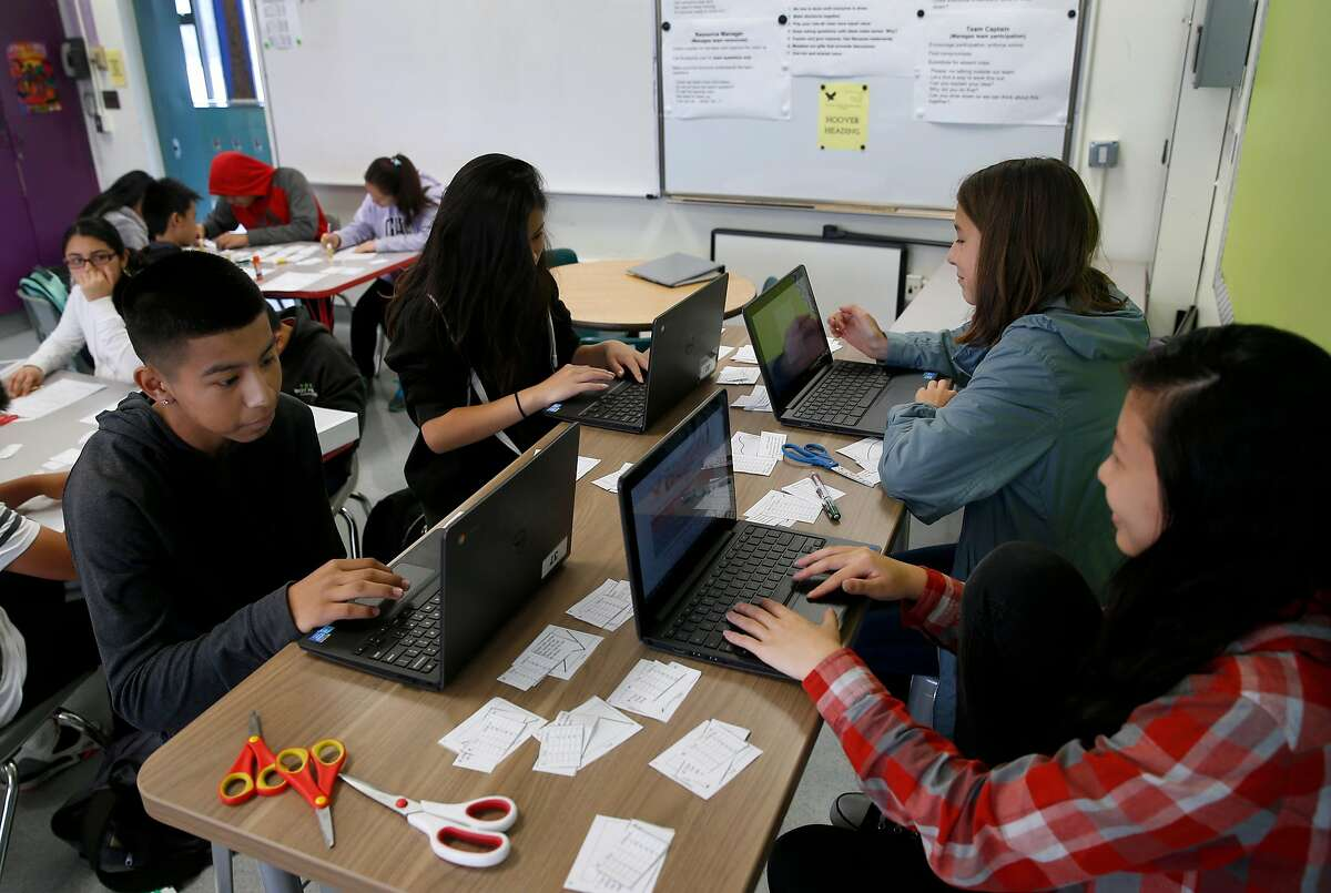 Students in Sarah Kochalko's 8th grade class complete schoolwork on laptops, provided by funding from Marc Benioff, at Herbert Hoover Middle School in San Francisco, Calif. on Aug. 31, 2016. Salesforce CEO and philanthropist Marc Benioff is announcing another year of grants to help fund San Francisco schools.