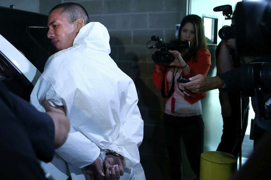 Ralph Torres is escorted out of police headquarters Wednesday, Aug. 31, 2016 on his way to jail. Police say Torres will be charged will capital murder for allegedly killing a convenience store clerk. SAPD also say he is a suspect in the shooting of two other people and at least 5 robberies, crimes he could be charged with later.