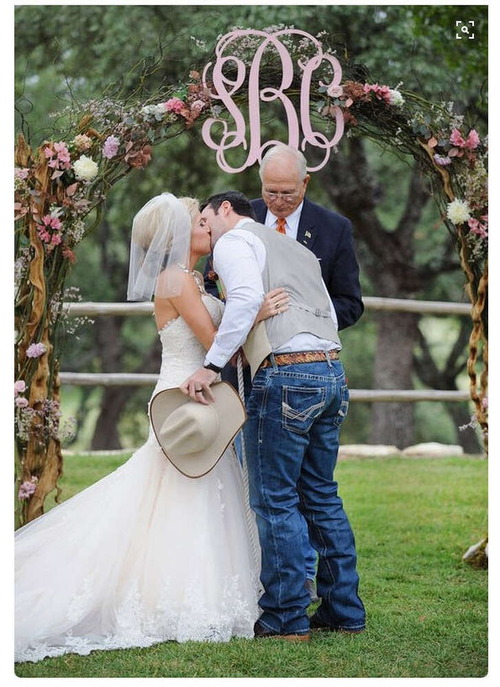 Cowboy it up:  Skip the suit and break out your favorite boots, hat and nicest jeans. No need for over-the-top fancy if you're doing a Texas wedding. 