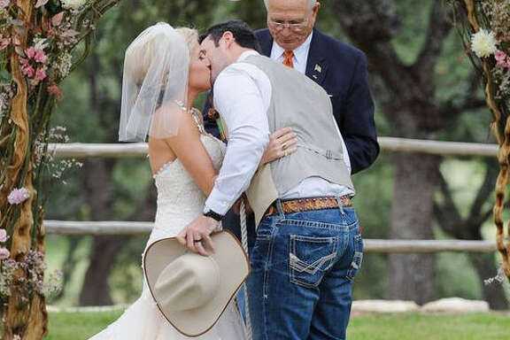 Cowboy it up:  Skip the suit and break out your favorite boots, hat and nicest jeans. No need for over-the-top fancy if you're doing a Texas wedding.  Photo: Pinterest