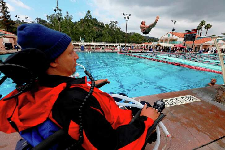 "Lenny Larsen III, 36, left, keep a close eye on his diver Patrick French on April 30, 2016 at the the Rose Bowl Aquatics Center in Pasadena, Calif. Lenny later said, ""I have always pushed people. I have always pushed the envelope forward, and I have always pushed myself forward."""