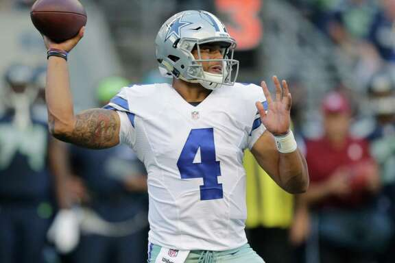 Dallas Cowboys quarterback Dak Prescott passes against the Seahawks during the first half of a preseason game on Aug. 25, 2016, in Seattle. Prescott grew up rooting for the Dallas Cowboys in Louisiana and suddenly finds himself in line to start their opener as a rookie quarterback with Tony Romo sidelined by yet another back injury.