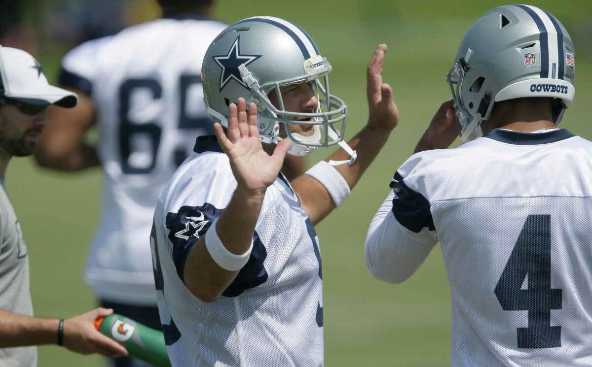 Dallas Cowboys quarterback Tony Romo (left) chats with fellow quarterback Dak Prescott during a minicamp at Valley Ranch in Irving on June 15, 2016.