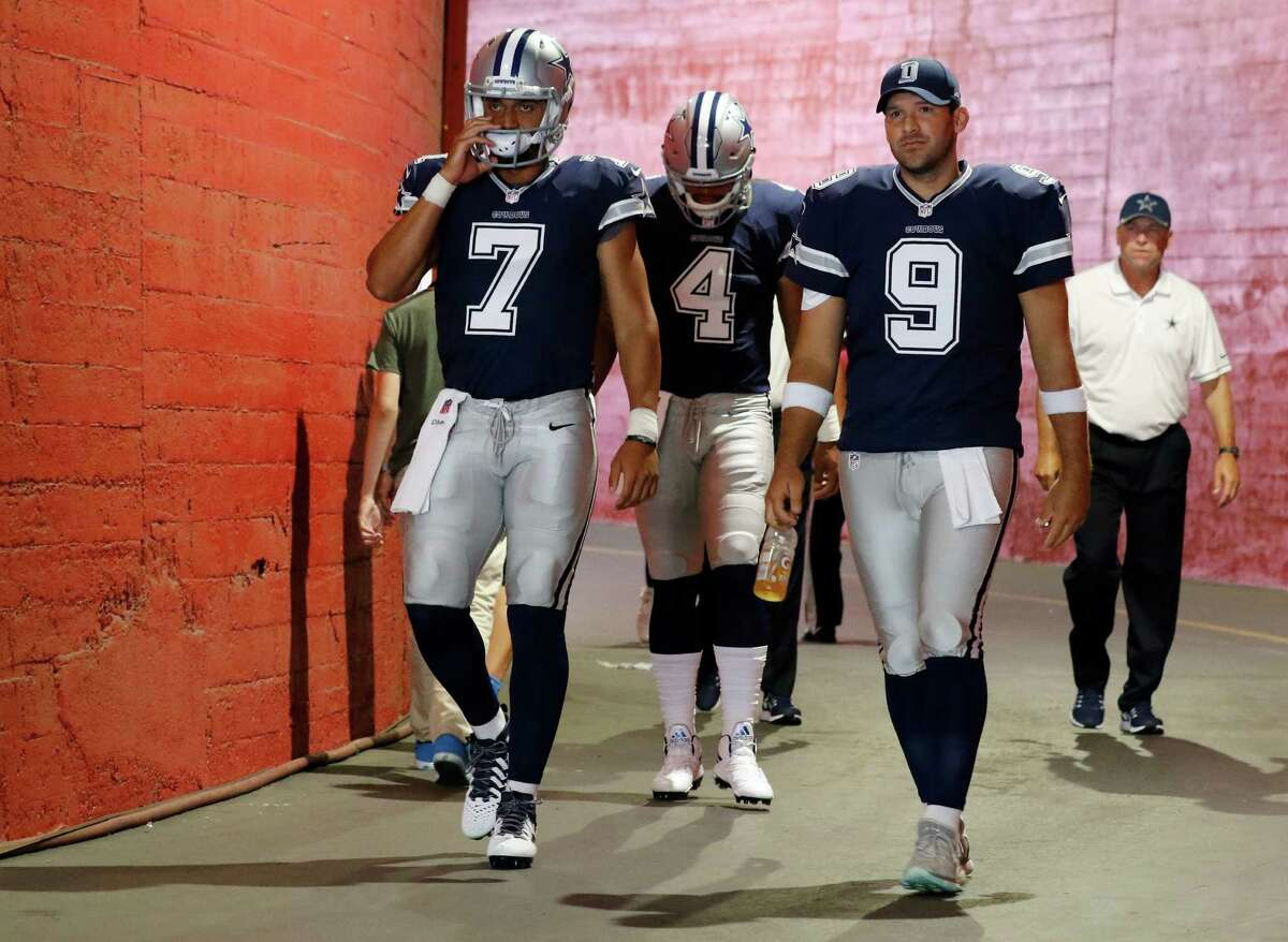 Dallas Cowboys quarterbacks Jameill Showers (7), Dak Prescott (4) and Tony Romo (9) walk out of the tunnel for warm-ups before a preseason game against the Rams on Aug. 13, 2016, in Los Angeles.
