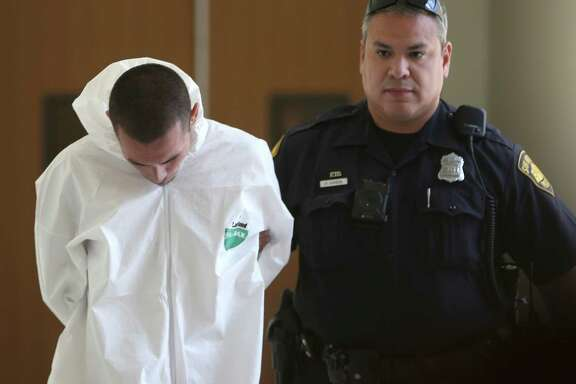 Ralph Torres, left, is escorted out of police headquarters Wednesday, Aug. 31, 2016 on his way to jail. Police say Torres will be charged will capital murder for allegedly killing a convenience store clerk. SAPD also say he is a suspect in the shooting of two other people and at least 5 robberies, crimes he could be charged with later.