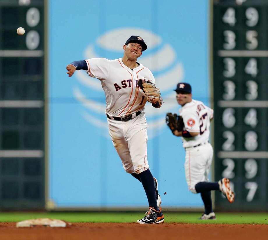 Houston Astros shortstop Carlos Correa (1) makes the throw to first base as Oakland Athletics Marcus Semien (10) grounded out during the sixth inning of an MLB game at Minute Maid Park, Wednesday, Aug. 31, 2016 in Houston. Photo: Karen Warren, Houston Chronicle / 2016 Houston Chronicle