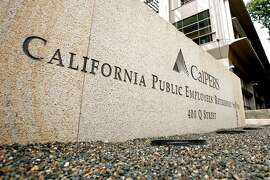 Signage stands outside the offices of the California Public Employees' Retirement System ( Calpers) in Sacramento, California, U.S., on Monday, Sept. 13, 2010. California Governor Arnold Schwarzenegger backed off a proposal to borrow $2 billion from the California Public Employees' Retirement System to help balance a state budget now almost three months overdue. Photographer: Ken James/Bloomberg