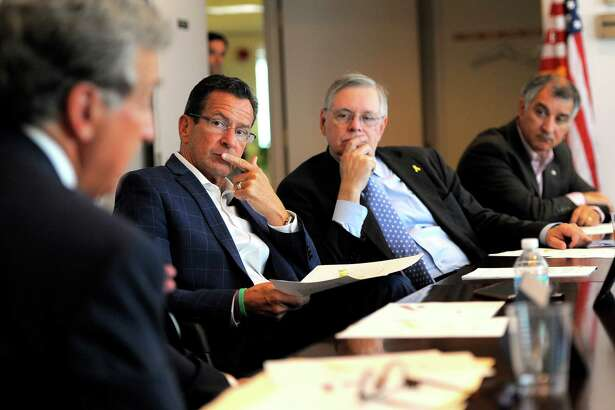 Gov. Dannell  Malloy, Stamford Mayor David Martin, and state Sen. Carlo Leone listen as Dr. Ted Andreadis speaks at a roundtable discussion on Zika preparedness and prevention held at the Government Center in Stamford, Conn. on Wednesday, Aug. 31, 2016.  To date, 61 Connecticut residents have become infected with the Zika virus, the mosquito-borne illness that is spreading at an alarming rate in warmer climates.