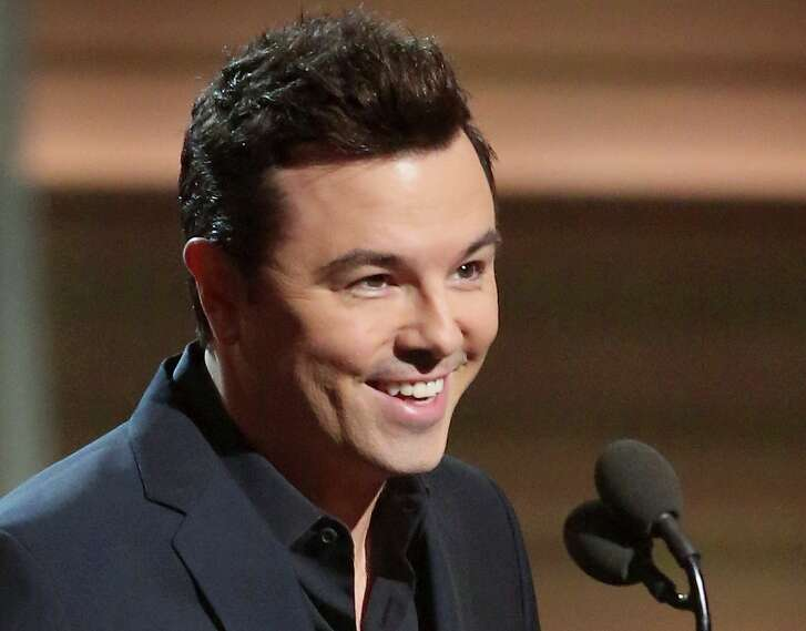 FILE - In this Feb. 15, 2016, file photo, Seth MacFarlane presents the award for best musical theater album at the 58th annual Grammy Awards in Los Angeles. The Boston Symphony Orchestra opens its outdoor season at Tanglewood, a New England rite of summer, on Friday, July 8, in Lenox, Mass. MacFarlaine is scheduled to perform there with the Boston Pops on Sunday, July 10. (Photo by Matt Sayles/Invision/AP, File)