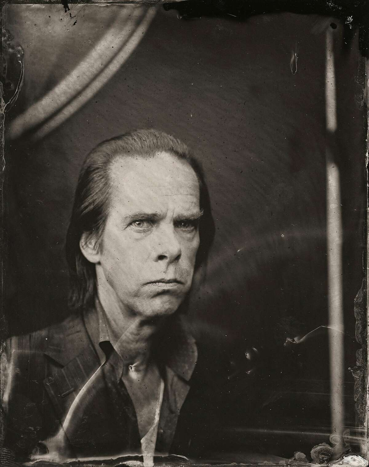 Nick Cave poses for a tintype (wet collodion) portrait at The Collective and Gibson Lounge Powered by CEG, during the 2014 Sundance Film Festival in Park City, Utah.