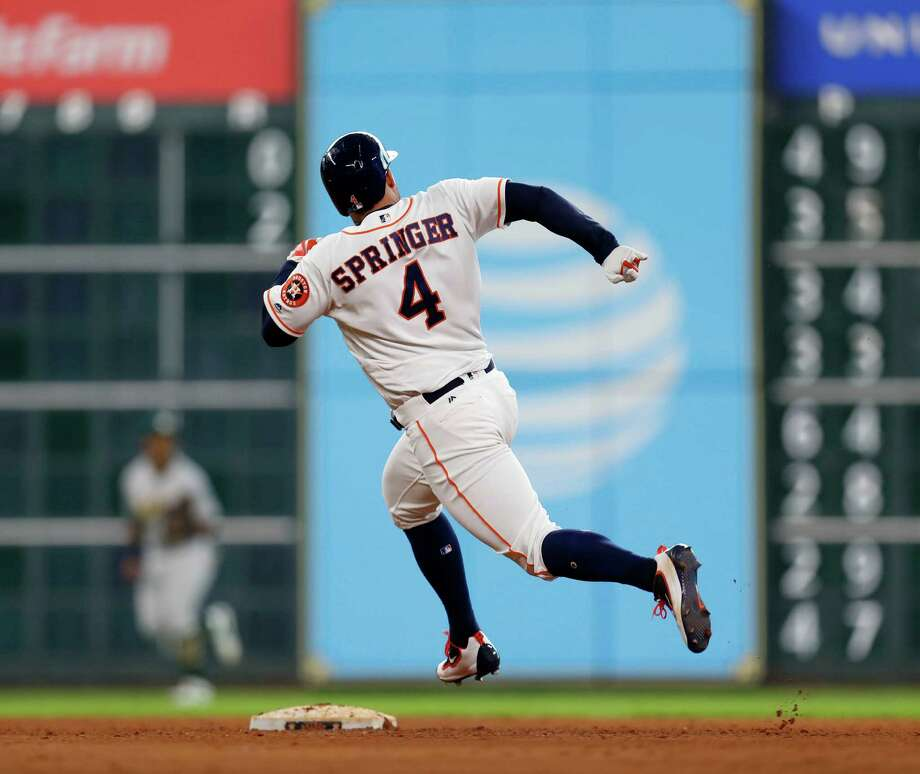 Houston Astros designated hitter George Springer (4) runs around second base on his way to third for a triple during the eighth inning of an MLB game at Minute Maid Park, Wednesday, Aug. 31, 2016 in Houston. Photo: Karen Warren, Houston Chronicle / 2016 Houston Chronicle