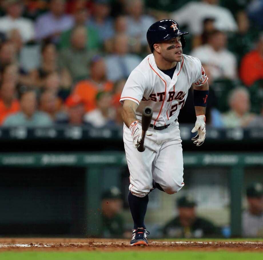 Houston Astros second baseman Jose Altuve (27) tosses his bat as he watches his ball fly out for an RBI triple, which tied the game during the eighth inning of an MLB game at Minute Maid Park, Wednesday, Aug. 31, 2016 in Houston. Photo: Karen Warren, Houston Chronicle / 2016 Houston Chronicle