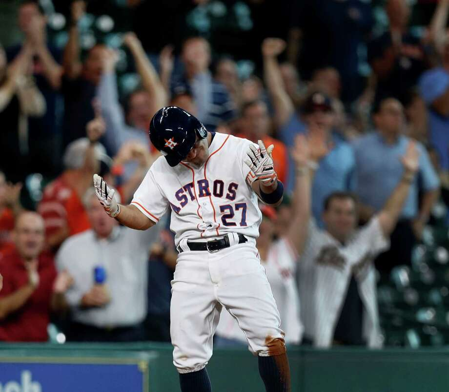 Houston Astros Jose Altuve's reacts on third base after his RBI triple tied the game during the eighth inning of an MLB game at Minute Maid Park, Wednesday, Aug. 31, 2016 in Houston. Photo: Karen Warren, Houston Chronicle / 2016 Houston Chronicle