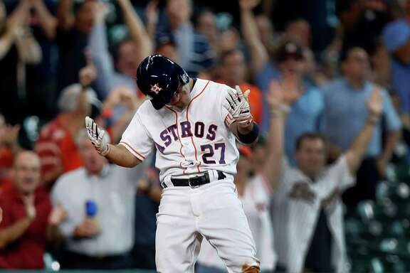 Houston Astros Jose Altuve's reacts on third base after his RBI triple tied the game during the eighth inning of an MLB game at Minute Maid Park, Wednesday, Aug. 31, 2016 in Houston.