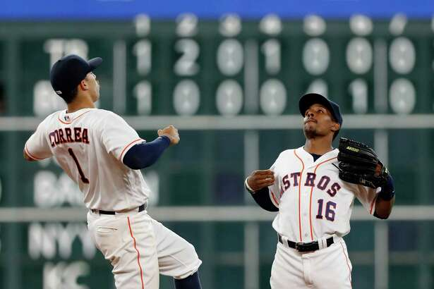 Houston Astros shortstop Carlos Correa (1) and Tony Kemp (16) celebrate the Astros 4-3 win over the Oakland Athletics after the final out of the ninth inning of an MLB game at Minute Maid Park, Wednesday, Aug. 31, 2016 in Houston.