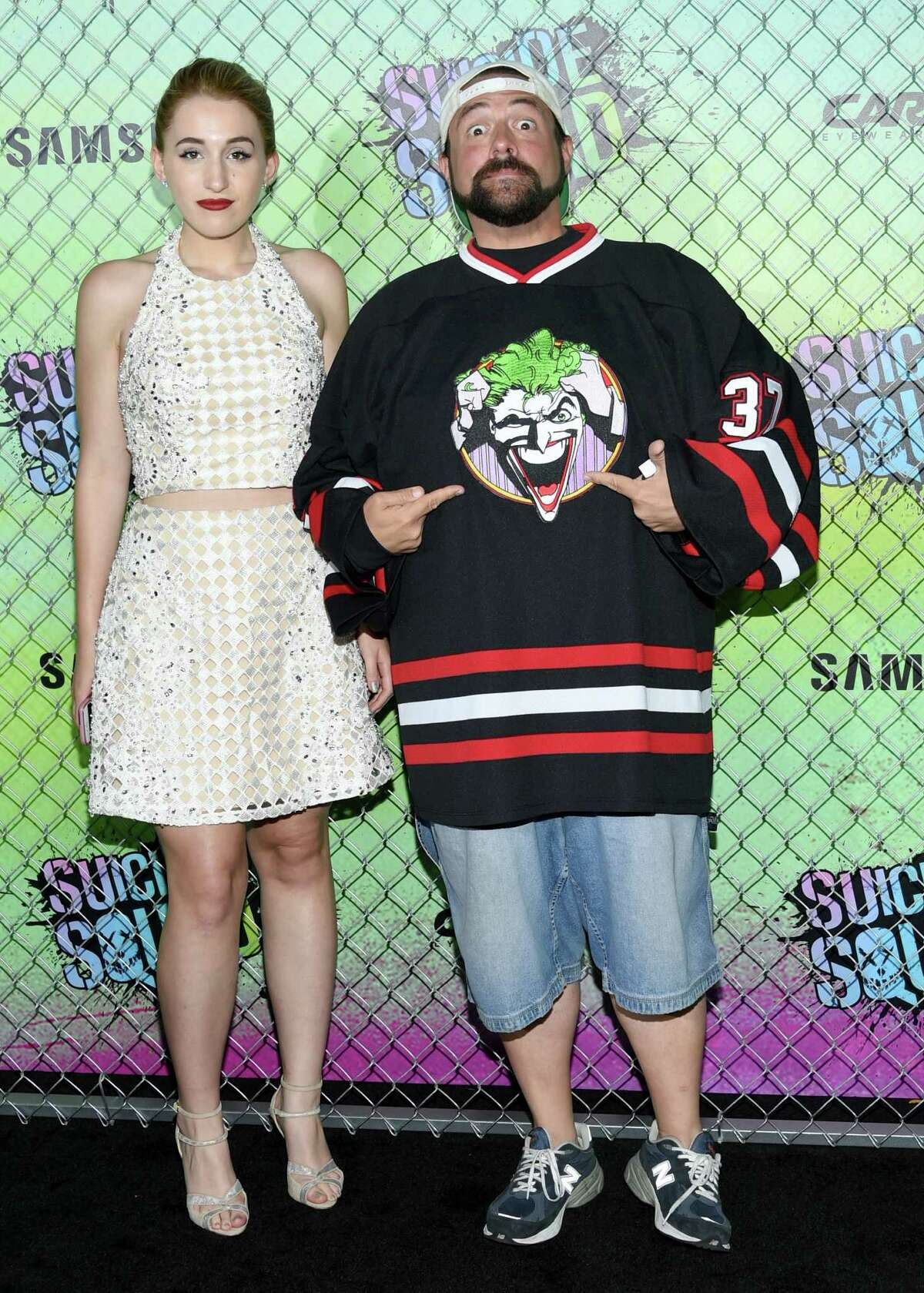 FILE - In this Aug. 1, 2016, file photo, Harley Quinn Smith, left, and her father, Kevin Smith, attend the world premiere of